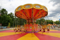 Carousel at amusement park. Orange carousel in an empty amusement park in late summer Stock Images
