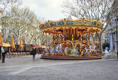 Carousel Avignon Market Square. An old fashioned carousel sits in the middle of the square in Avignon, France Stock Photos