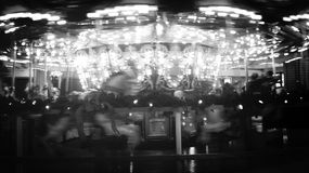 Carousel. A black and white carousel in motion royalty free stock photography