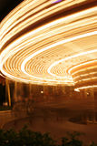 Carousel Blur. The blurred movement of lights on a carousel ride in an amusement park Stock Photo
