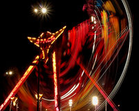 Carousel. Blurred motion circular carousel during the evening festivities on Piotrkowska Street in Lodz.n Stock Images