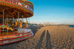 Carousel Brighton beach with two silhouettes Royalty Free Stock Photography