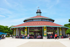 Carousel at Brookfield Zoo. BROOKFIELD, ILLINOIS - MAY 27, 2017: The Carousel at Brookfield Zoo. The ride is popular attraction of the park with families and Stock Image