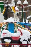 Carousel car in snow Royalty Free Stock Photos