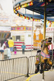 Merry-Go-Round. A carousel at a carnival Royalty Free Stock Image