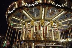 Carousel in Christmas night Stock Image