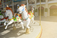 Carousel in the city with sunlight Stock Photography