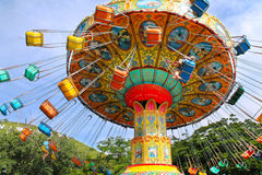 Carousel. Colorful attractions on the circuit in amusement park bottom view Stock Image