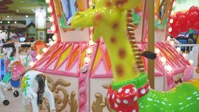 Carousel colorful slow spin playground stock video footage