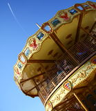 Carousel and contrail Stock Photos