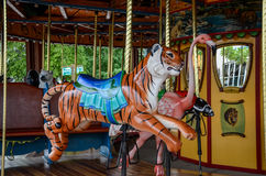 Carousel Designs. Bright colorful fun merry-go-round at a amusement park children and adults ride for entertainment Royalty Free Stock Photo