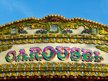 Carousel detail - colorful sign. Word carousel written on bright and colorful carousel Stock Images