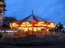 Carousel at dusk. FunForest carousel next to the Space Needle in Seattle Royalty Free Stock Image