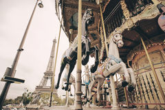 Carousel and Eiffel Tower in Paris Stock Images