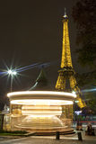 Carousel and the Eiffel Tower in Paris Stock Photos