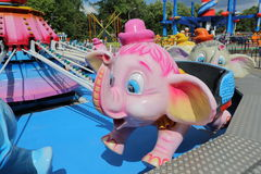 Carousel with elephants. Children carousel with toy elephant in the amusement park Stock Photos