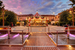 Carousel at evening in city center. Alba, Italy. ALBA, ITALY - OCTOBER 27: Illuminated carousel at city central square in Alba during annual White Truffle Royalty Free Stock Photos