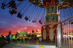 Carousel. Evening time carousel on dark blue and red sky in Amusement Park. Sunset saturated color on background. Long beach island Jersey shore NJ Stock Photography