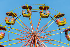 Carousel ferris wheel against a blue sky Royalty Free Stock Images