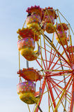 Carousel ferris wheel against a blue sky Royalty Free Stock Image