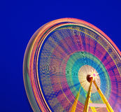Carousel. Ferris Wheel on a blue background. Stock Images
