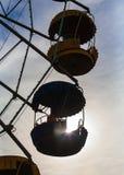 Carousel ferris wheel. Cabin carousel in the setting sun Royalty Free Stock Image