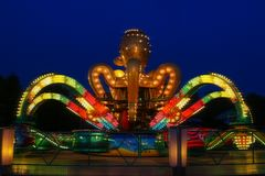 Carousel in the form of an octopus in an amusement park. stock image