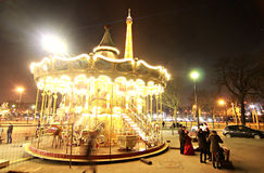 Carousel in front of the Eiffel Tower, Paris. A carousel slowly rests in front of the Eiffel Tower in Paris, France Stock Image