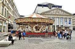 Carousel in front of the Royal Theatre la Monnaie in Brussels Royalty Free Stock Photography