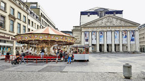 Carousel in front of the Royal Theatre la Monnaie in Brussels Stock Photography