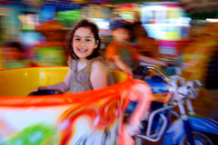Carousel Fun. Little girl having fun in a carousel Royalty Free Stock Images