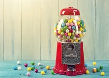 Carousel Gumball Machine Bank. On a wooden background royalty free stock photography