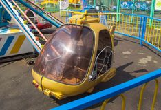 Carousel helicopter toys in an empty amusement Park in spring.  Stock Photography