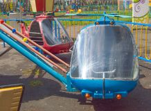 Carousel helicopter toys in an empty amusement Park in spring.  Royalty Free Stock Photography