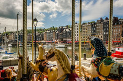 Carousel in Honfleur Frence shippers habour. Carousel in Honfleur Frence shippers habour with nice clouds Stock Photography