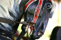 Carousel horse. Closeup of a carousel horses head and reins Royalty Free Stock Images
