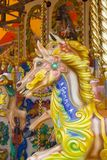 Carousel horse. Brightly painted wooden horse called Gemma on fairground ride Stock Image