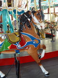 Carousel Horse. On an amusement park ride stock image