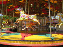 Carousel horse merry go round. Summer british merry go round horses painted Royalty Free Stock Photo