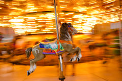 Carousel horse panning royalty free stock photography