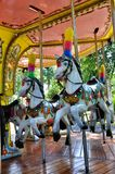 Carousel horse. Picture of a Retro Carousel Horse with the background of the Carousel Stock Photography