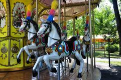 Carousel horse. Picture of a Retro Carousel Horse with the background of the Carousel Stock Image