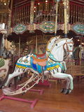 Carousel horse. Carousel White HorsesrnRound and round they gornNice time for children to play Royalty Free Stock Photo