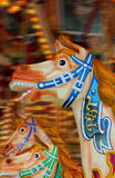 Carousel Horses. With motion blur background Royalty Free Stock Photo