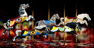 Carousel Horses. A group of merry - go - round or carousel horses with bright lights backdrop with musical notes stock images