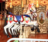 Carousel horses. Row of three carousel horses Stock Photo