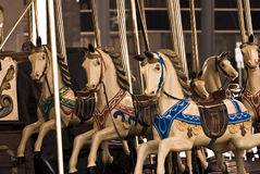 Carousel horses. Golden horses on an old carousel royalty free stock photos