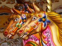 Carousel horses. In amusement park Royalty Free Stock Photos