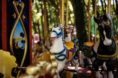 Carousel with Horses on a carnival Merry Go Round Stock Photo