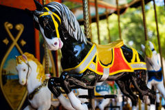 Carousel with Horses on a carnival Merry Go Round Stock Image